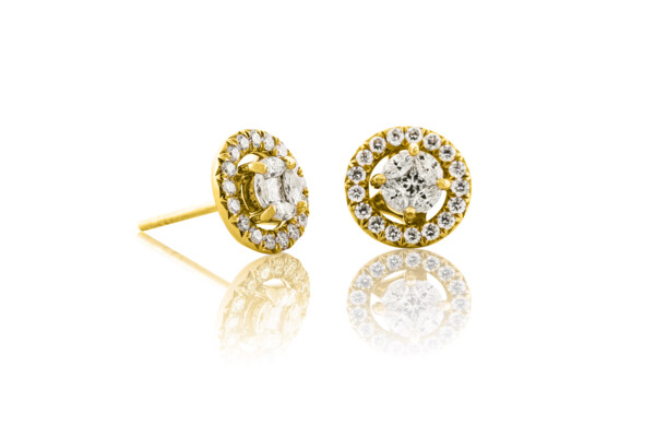 Closeup photo of Marquis Diamond Stud Earrings With Removable Diamond  Halo Jacket