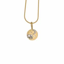 Closeup photo of Elephant baby and moon pendant