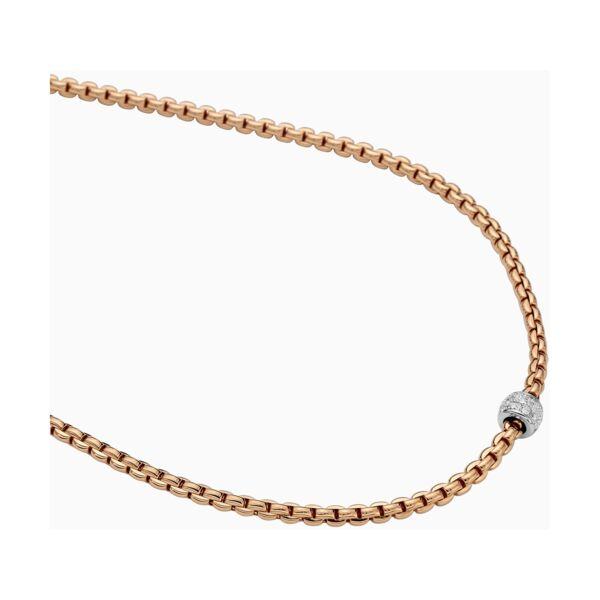 Closeup photo of EKA Tiny Necklace with Diamond Pavé