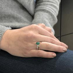 Closeup photo of 18k Yellow Gold Emerald Cut Zambian Emerald Ring with Split Diamond Shank Band