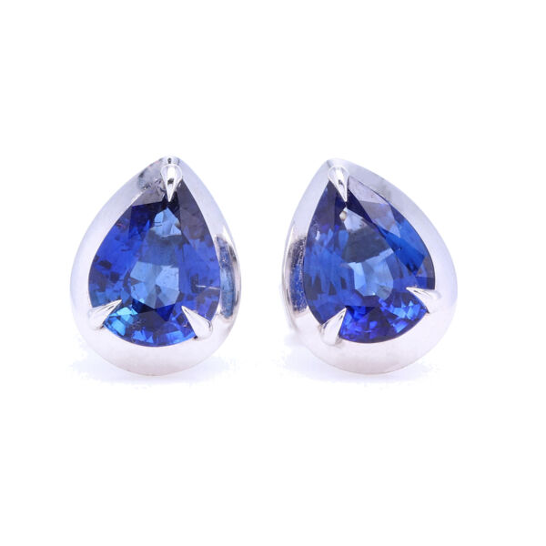 Closeup photo of Pear Shaped Blue Sapphire Bezel Set Studs