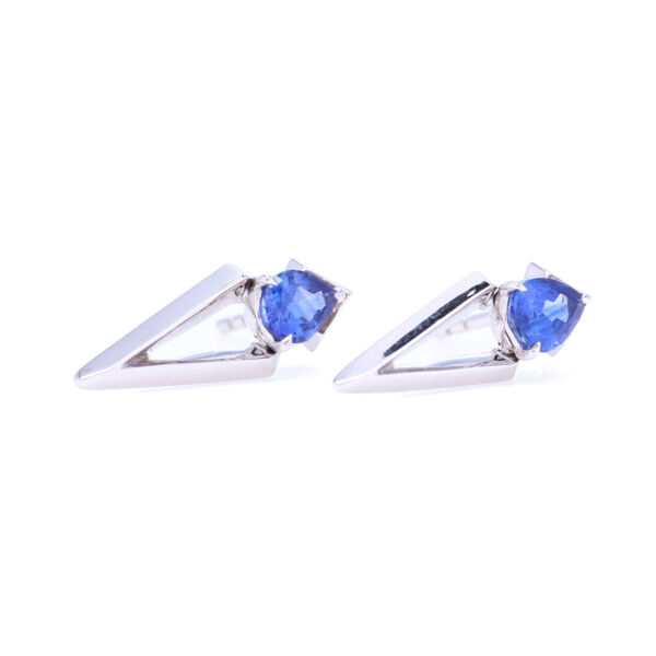 Closeup photo of Pear Cut Blue Sapphire Abstract Studs