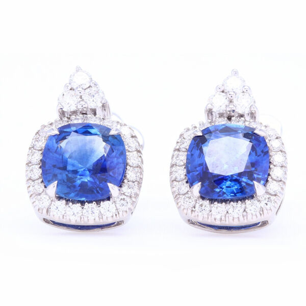 Closeup photo of Cushion Blue Sapphire Studs with Diamond Halo