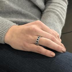Closeup photo of Diamond Halo Set Round Blue Sapphire Eternity Ring