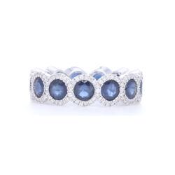 Closeup photo of 18k White Gold Diamond Halo Set Round Blue Sapphire Eternity Ring