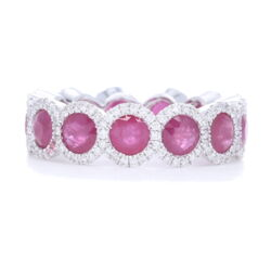 Closeup photo of Halo Set Ruby Eternity Ring set in 18k White Gold