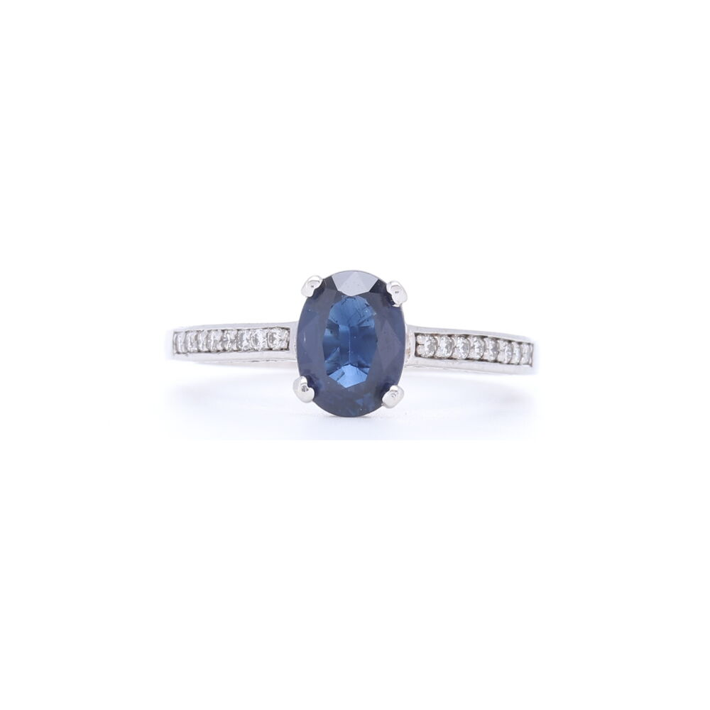 Stunning Blue Oval Shaped Sapphire Ring with Diamonds 1/2 down the Shank