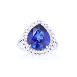 Closeup photo of 14k Halo Brilliant Cut Diamonds Around Diffused Pear Shaped Sapphire Ring