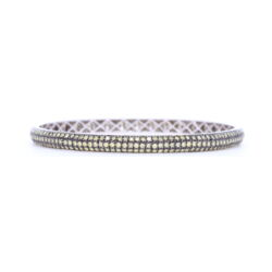 Closeup photo of Tyre Bangle Bracelet with Green Diamonds set in 18k White Gold