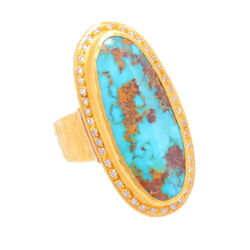 Closeup photo of Elongated Turquoise and Diamond Ring