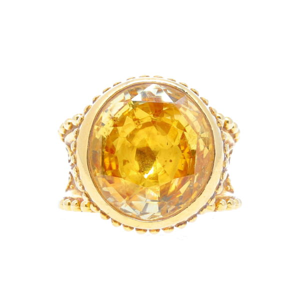Closeup photo of Cynthia Bach Oval Scroll Yellow Sapphire Ring