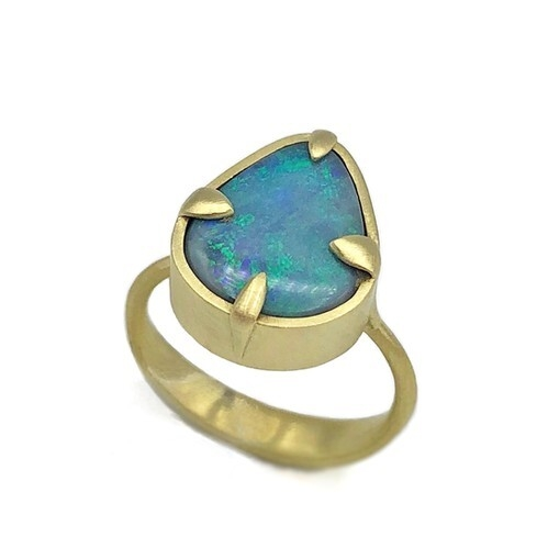 Closeup photo of Teal Pear-Shaped Opal Amazon Ring
