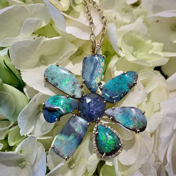 Closeup photo of Abstract Boulder Opal & Tanzanite Gema Flower Pendant