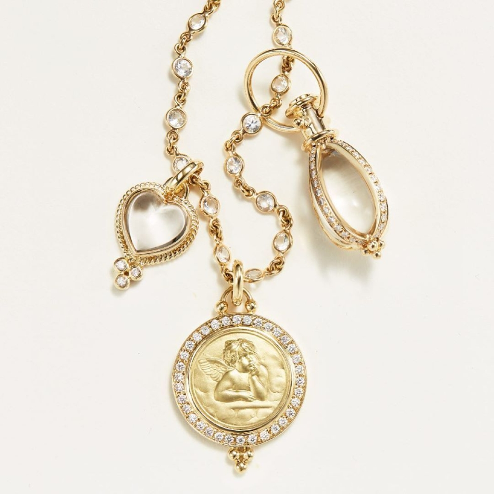 Image 2 for Small 18K yellow Gold Classic Amulet with oval rock crystal and Four sides of pave' diamonds.