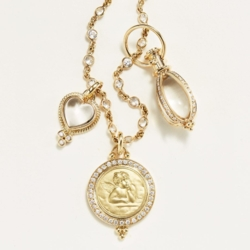 Closeup photo of Small 18K yellow Gold Classic Amulet with oval rock crystal and Four sides of pave' diamonds.