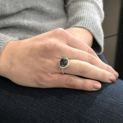 Closeup photo of 18K Tourmaline Cabochon Ring with Diamond Halo