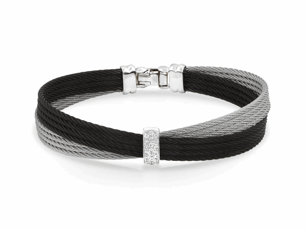 Closeup photo of Noir Crossed Black Cable Bangle with Small Vertical Diamond Bar