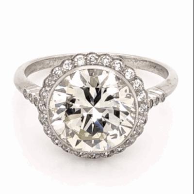 Closeup photo of Platinum 1950's 3.97ct Round Brilliant Diamond & .24tcw side Diamond Ring with Milgrain, s7.5