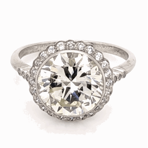 Closeup photo of Platinum 1950's 3.97ct Round Brilliant Diamond & .24tcw side Diamond Ring with Milgrain, s7.5