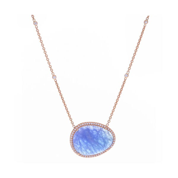 Closeup photo of Rough Tanzanite and 18k Rose Gold Pendant Necklace
