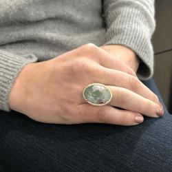 Closeup photo of Oval Aquaprase Ring with Diamond Halo