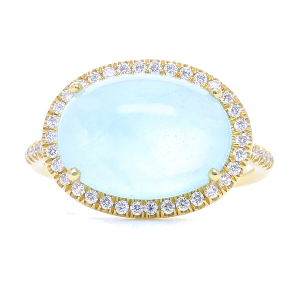 Closeup photo of 18k Yellow Gold, Diamond Halo Cabochon Aquamarine Ring