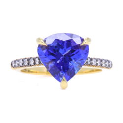 Closeup photo of 18k Yellow Gold and Black Rhodium, Diamond Shank Trillion Tanzanite Ring