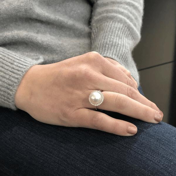 Closeup photo of White South Sea Pearl and Diamond Halo Ring