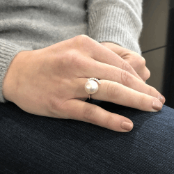 Closeup photo of White South Sea Pearl Ring Framed with Diamonds